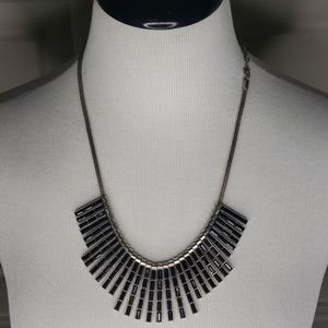 Silver collar necklace with black stones